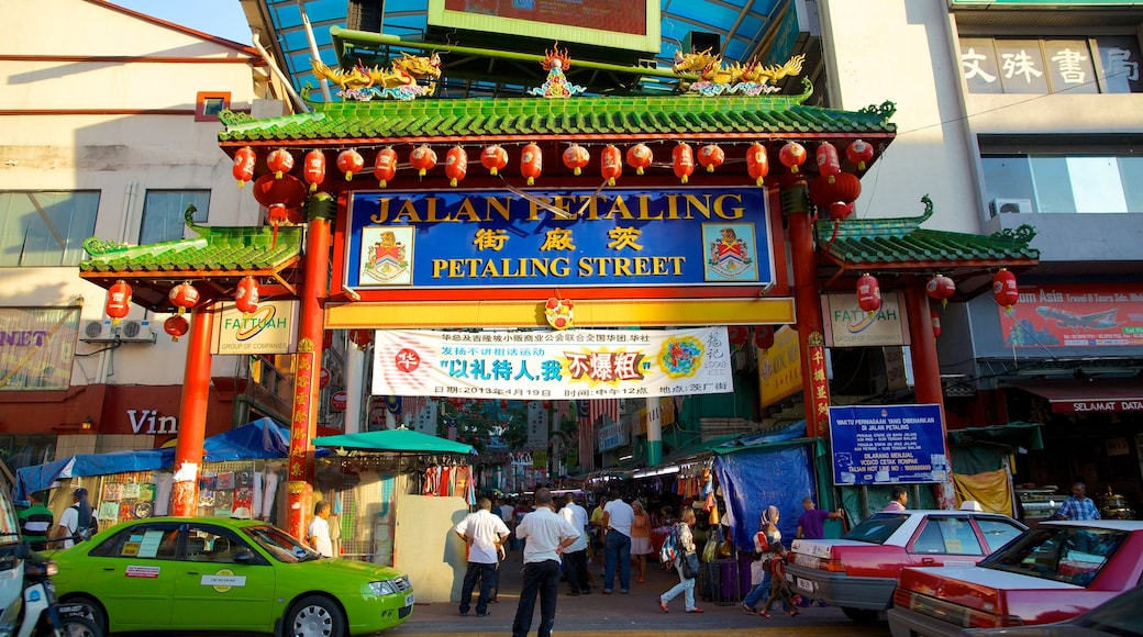 Petaling Street showing signage, a city and street scenes