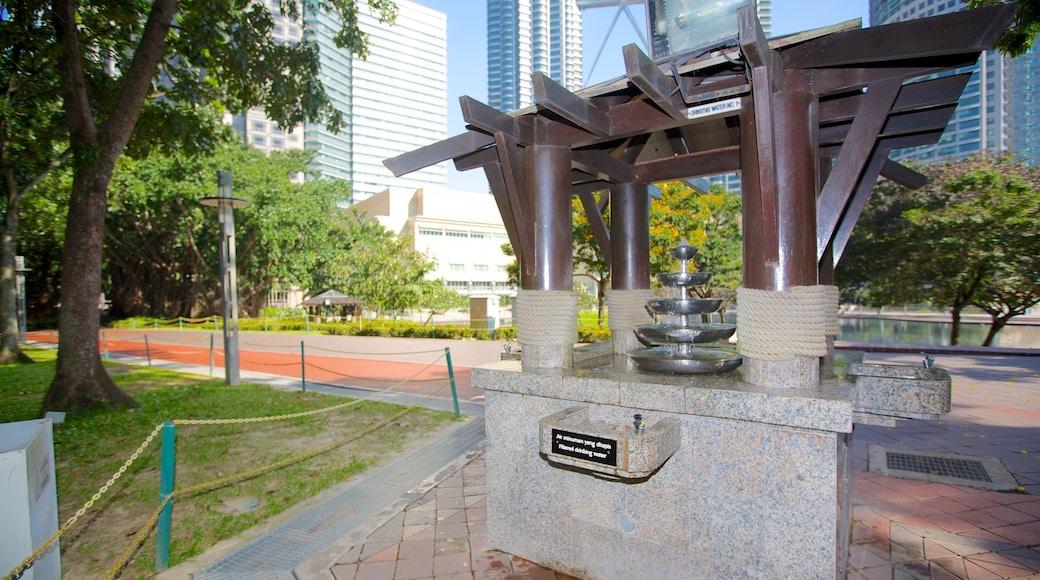 KLCC Park showing a fountain and a garden