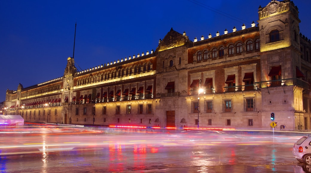 Palacio Nacional featuring a city, night scenes and heritage architecture