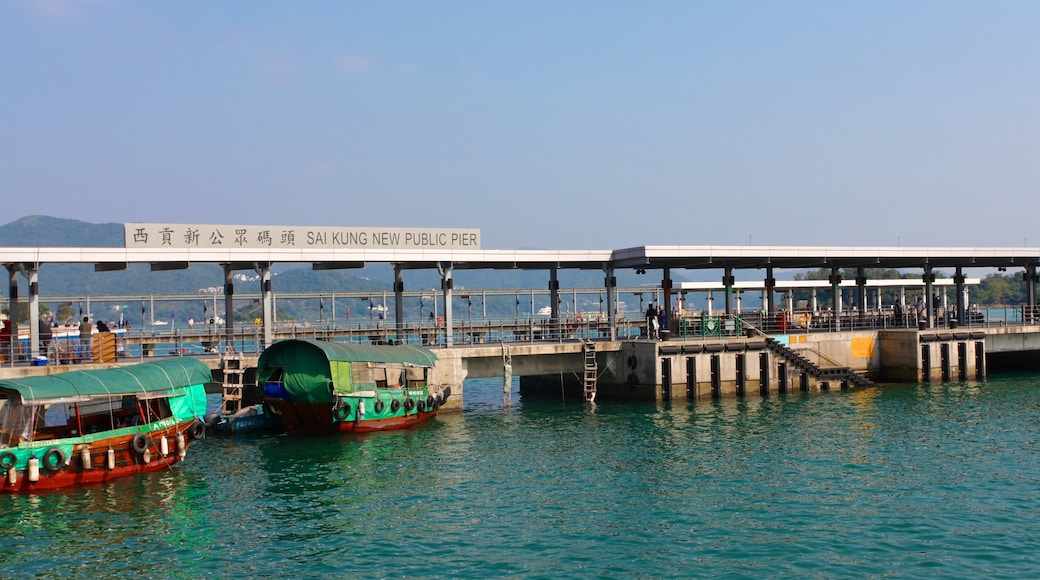 Sai Kung which includes signage, a bay or harbour and general coastal views