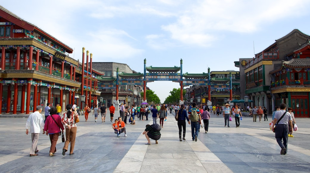 Front Gate featuring a square or plaza and a city as well as a large group of people