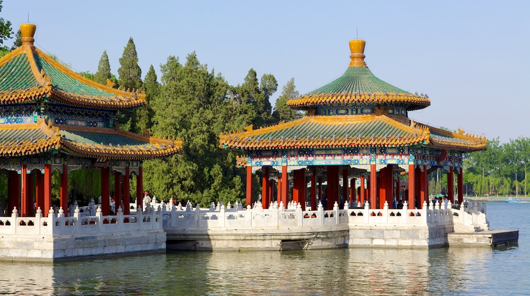 Beihai Park which includes a river or creek, heritage architecture and a temple or place of worship