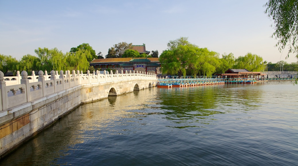 Beihai Park which includes a temple or place of worship, a river or creek and a bridge