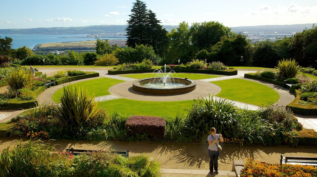 Belfast Castle featuring a fountain, a garden and a castle