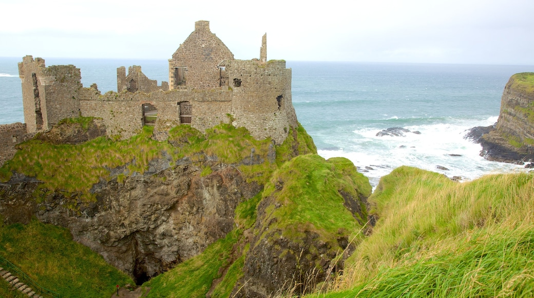 Dunluce Castle featuring heritage elements, general coastal views and a ruin