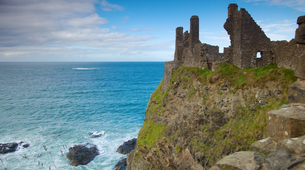 Dunluce Castle which includes rugged coastline, a castle and building ruins