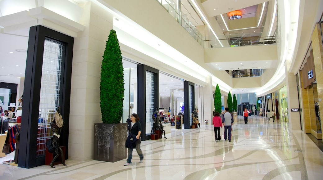 Shinsegae Centum City featuring shopping and interior views