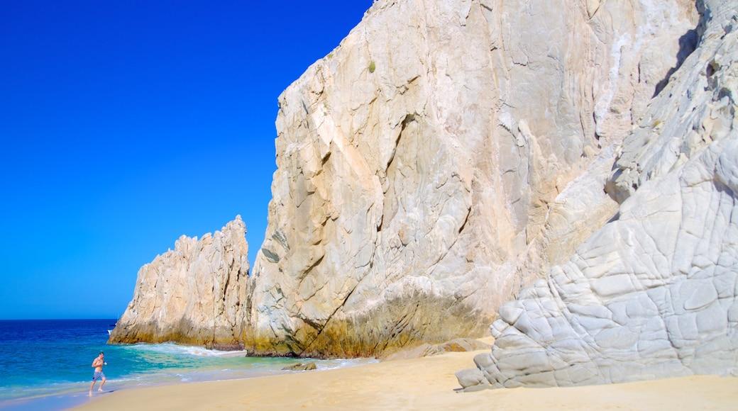 Playa del Amor showing a beach and rocky coastline