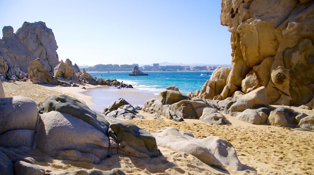 Playa del Amor showing a sandy beach, landscape views and rocky coastline