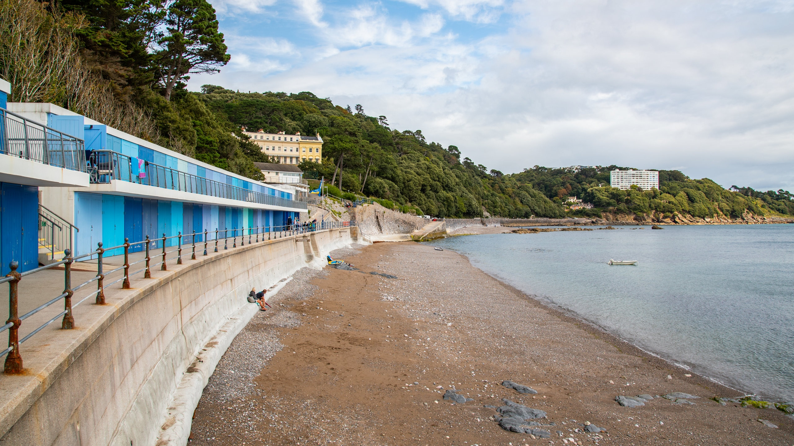 Walk along a scenic coastal path from Torquay Harbour to reach this well-maintained beach, a favorite with water sports fans.