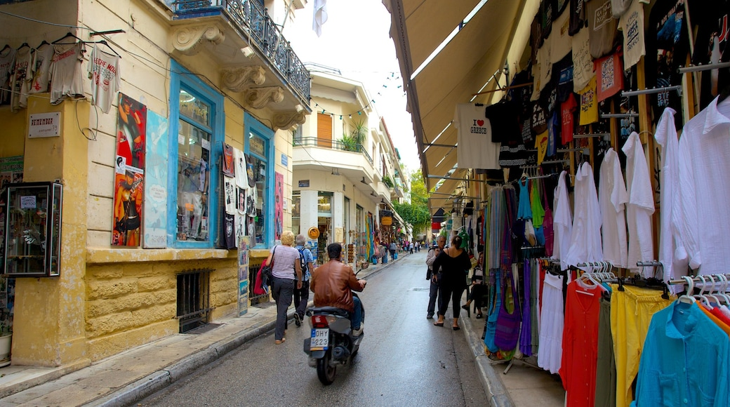 Athens which includes markets, a city and motorcycle riding
