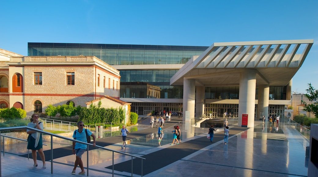 Acropolis Museum featuring a city as well as a large group of people