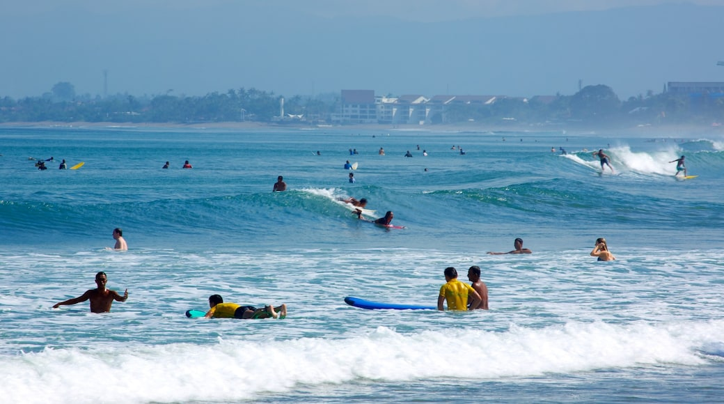 Kuta Beach showing surf, swimming and surfing