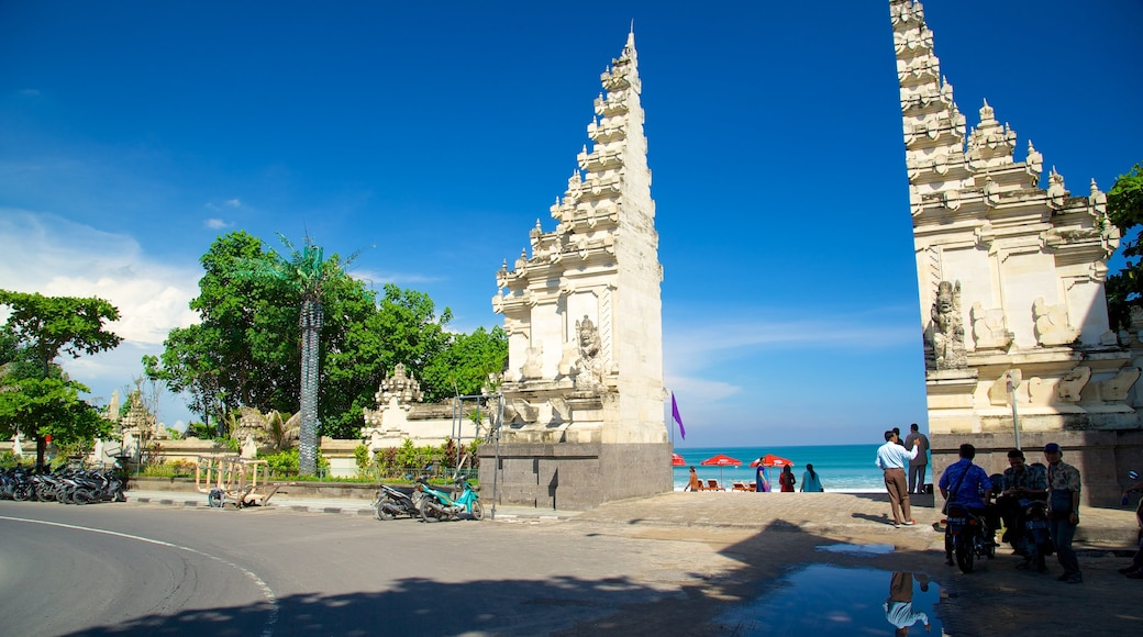 Kuta Beach which includes street scenes and general coastal views