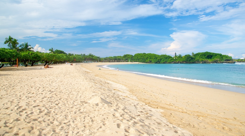Nusa Dua Beach which includes a sandy beach and tropical scenes