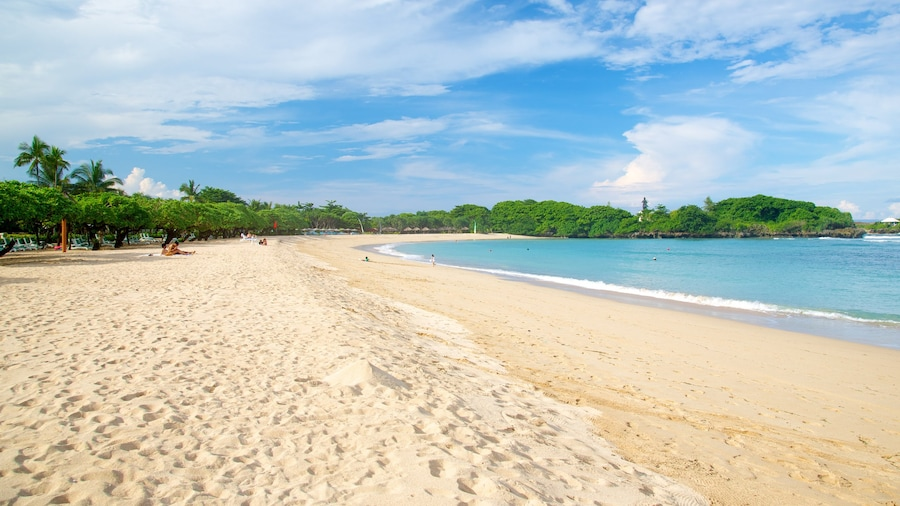 Nusa Dua Beach featuring a beach and tropical scenes