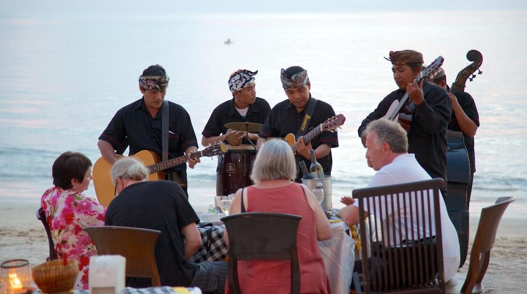 Jimbaran Beach which includes music, performance art and general coastal views