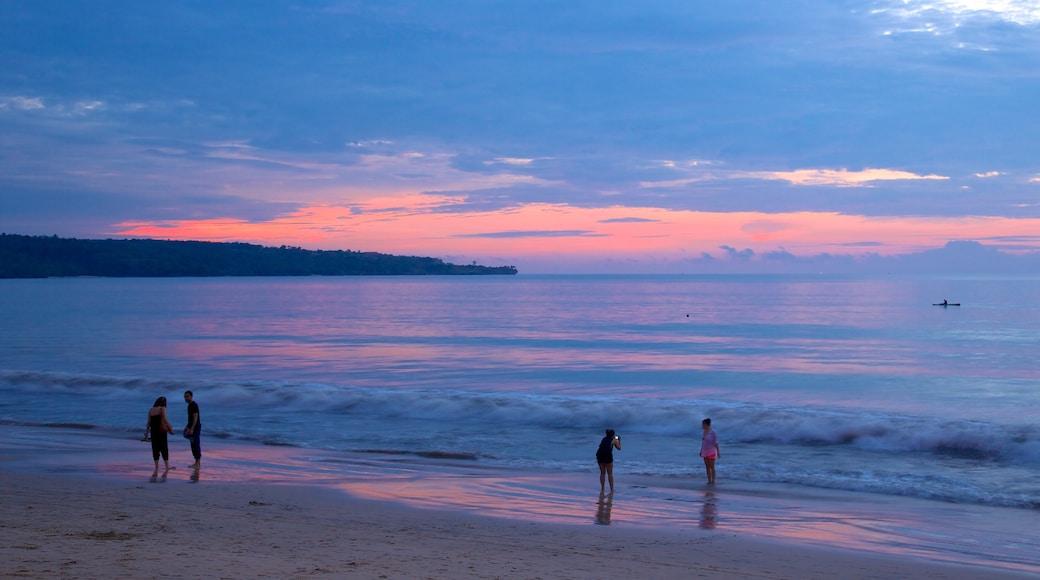 Jimbaran Beach showing a sunset and a sandy beach