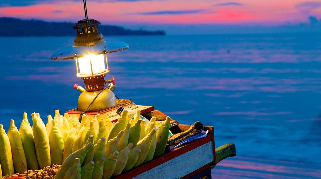 Jimbaran Beach showing food and a sunset