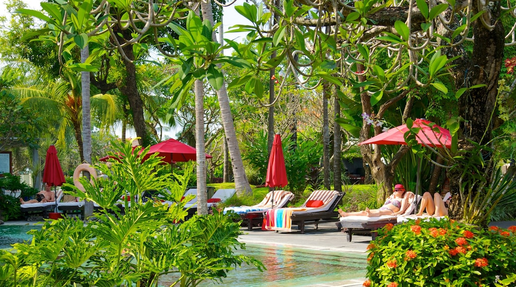 Segara Beach which includes a pool and a luxury hotel or resort