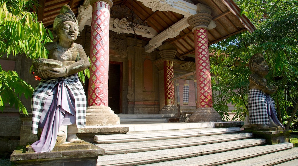 Agung Rai Museum of Art featuring a temple or place of worship, a monument and religious elements