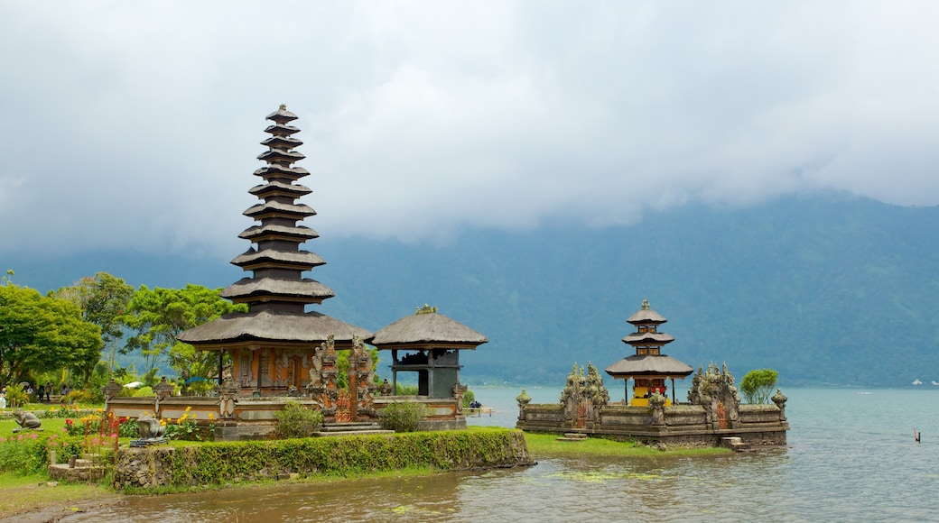 Ulun Danu Temple which includes general coastal views, religious elements and a temple or place of worship