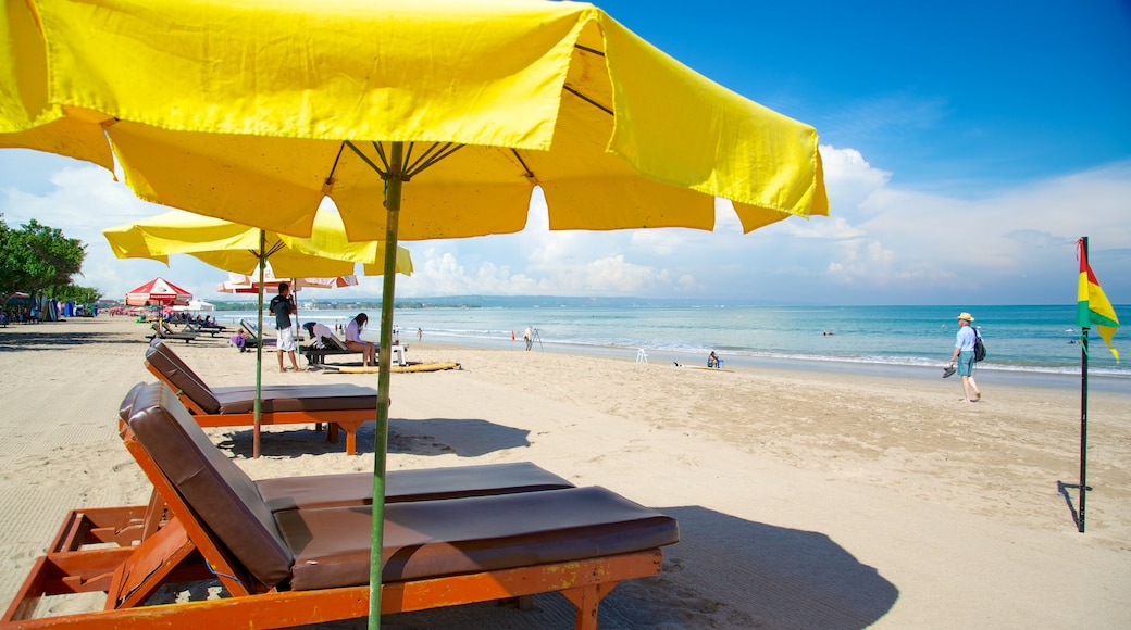 Legian Beach which includes a luxury hotel or resort and a sandy beach