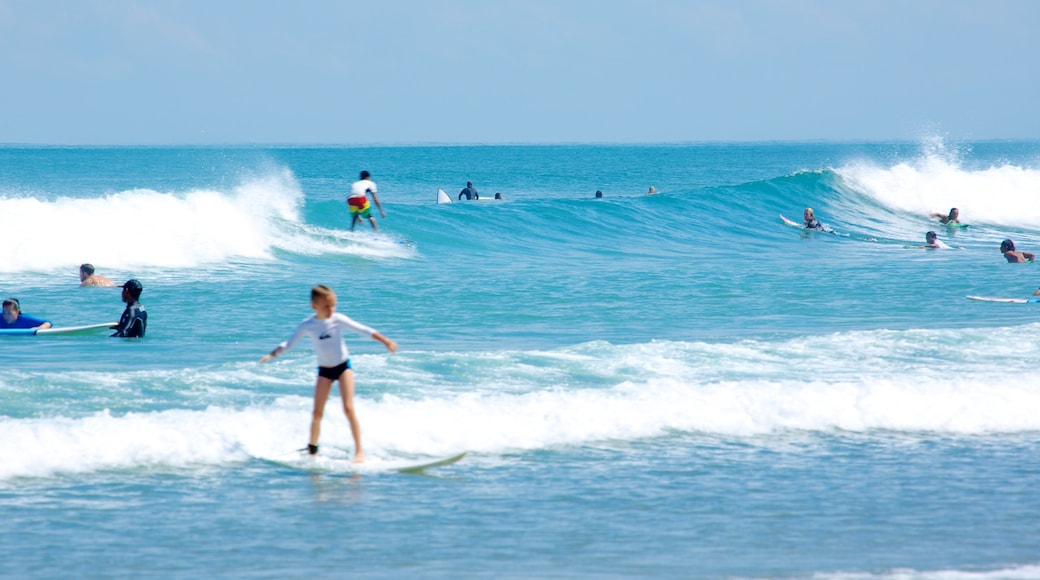 Double Six Beach showing surf and surfing as well as an individual child