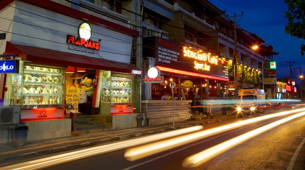 Kuta featuring street scenes, night scenes and a city