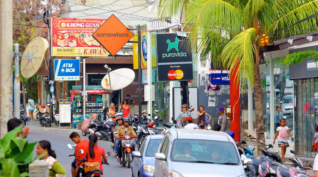 Seminyak which includes a city and street scenes as well as a large group of people