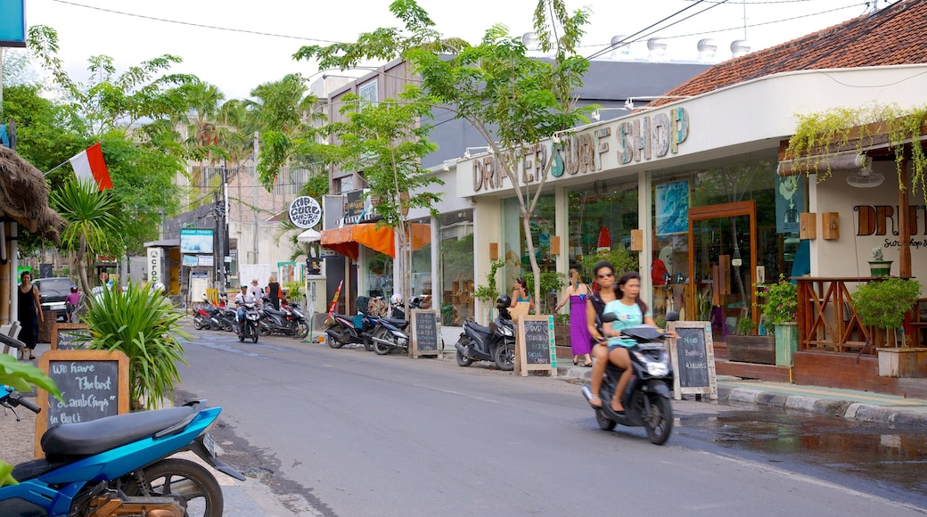 Seminyak featuring street scenes, motorcycle riding and a city