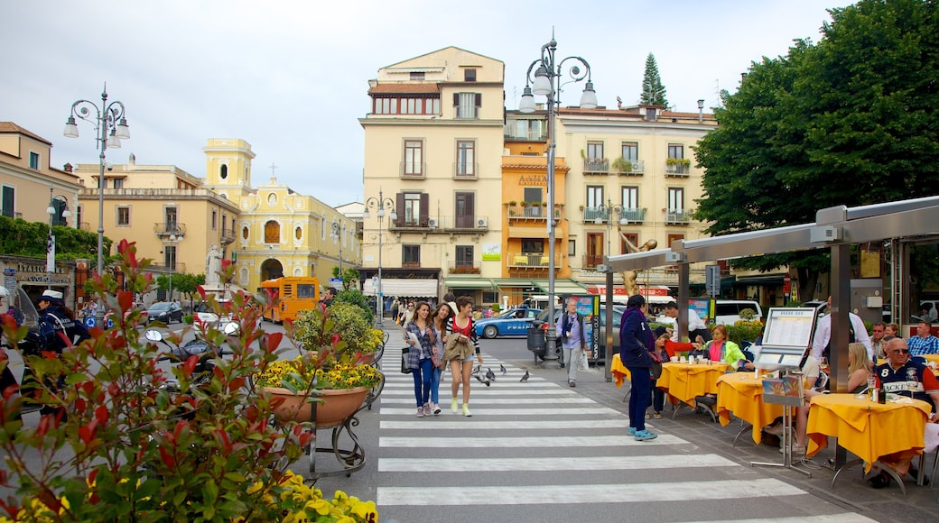 Piazza Tasso showing street scenes and a city as well as a large group of people