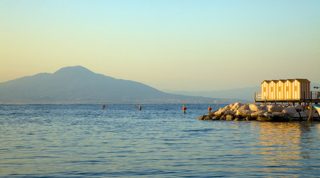 Marina Grande which includes a sunset and rocky coastline