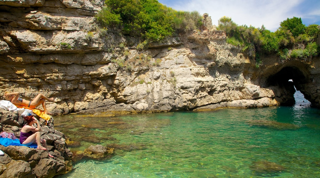 Baths of Queen Giovanna which includes rocky coastline as well as a small group of people