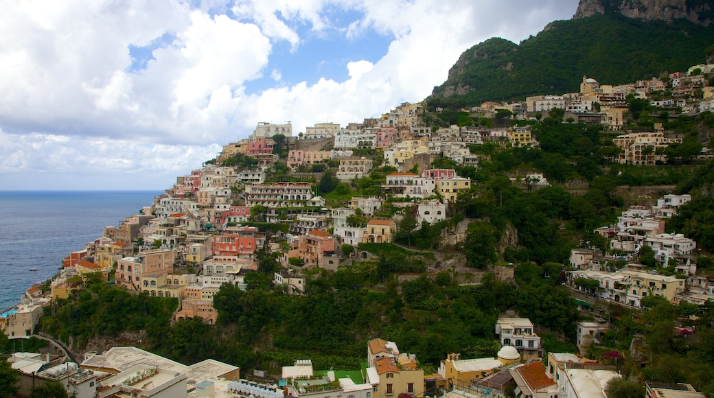Positano which includes a coastal town, a city and mountains