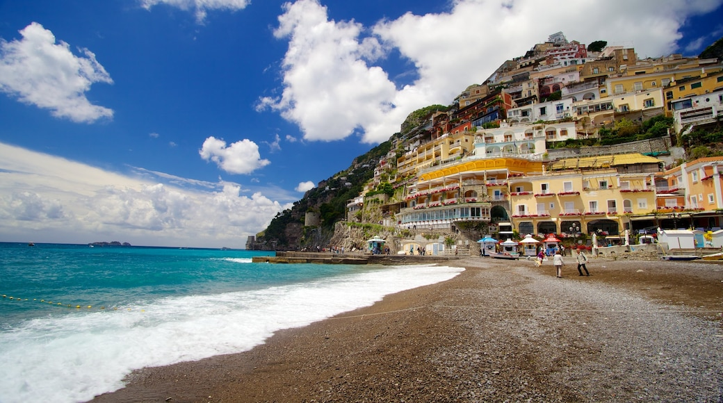 Positano featuring a coastal town and a beach
