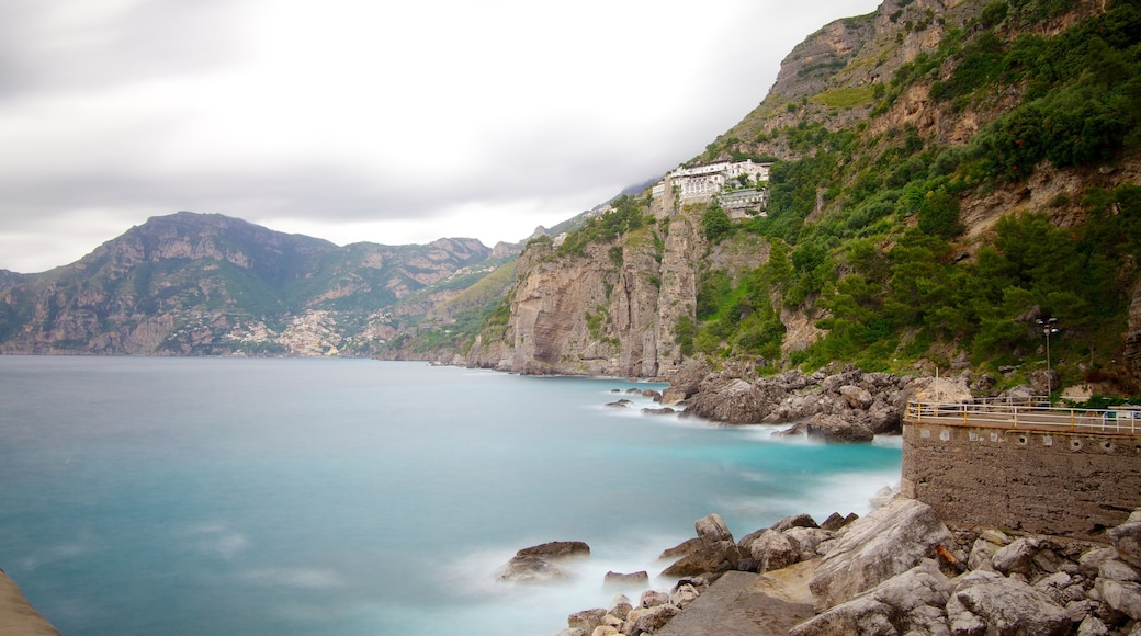 Praiano which includes rocky coastline and mountains