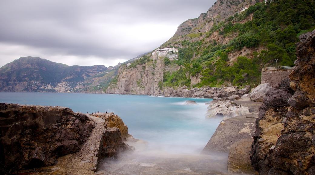 Praiano showing general coastal views, rugged coastline and mist or fog
