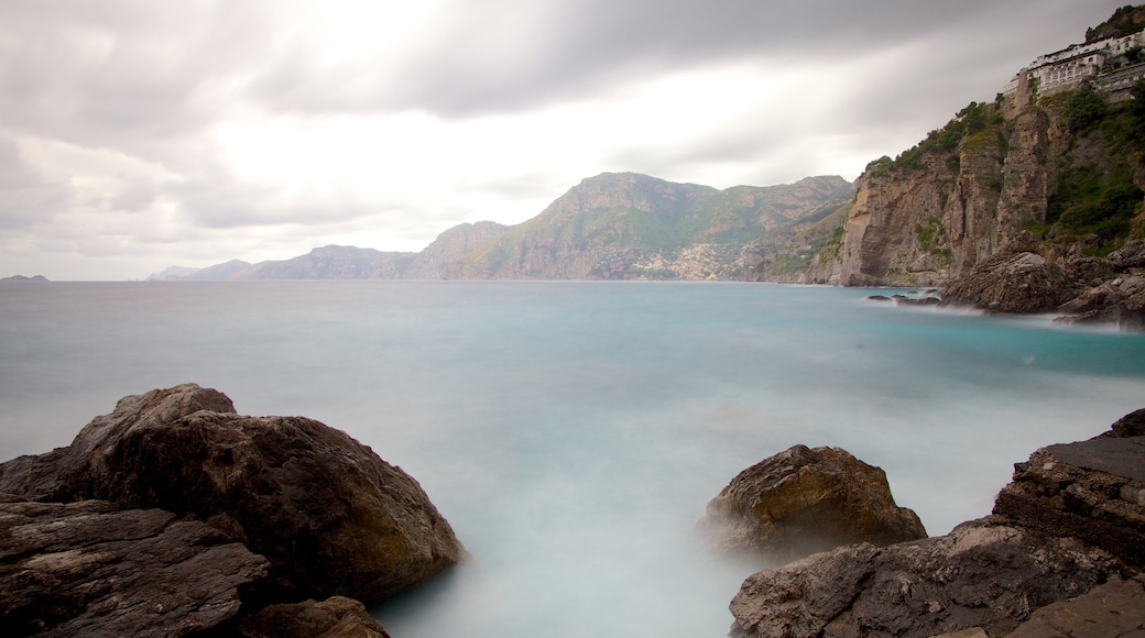 Praiano showing rocky coastline and mist or fog