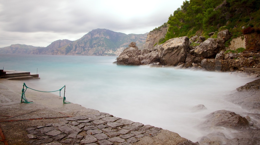 Praiano which includes mist or fog and rugged coastline