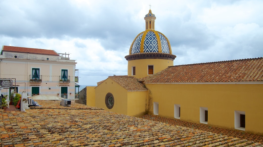 Praiano which includes a church or cathedral and a city