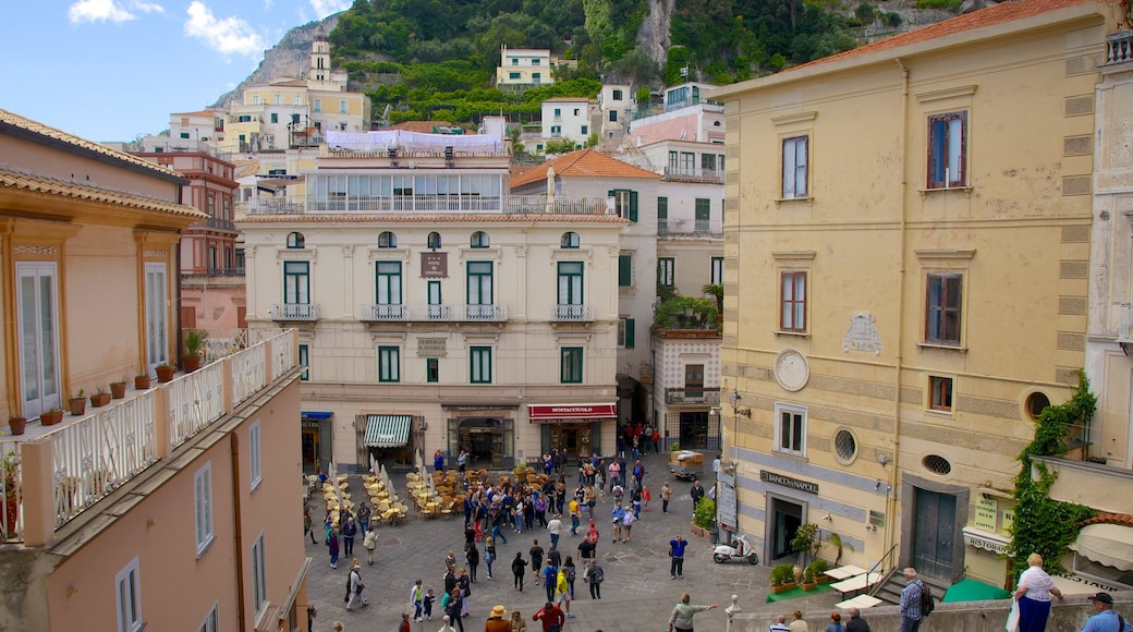 Amalfi Coast showing a city as well as a large group of people