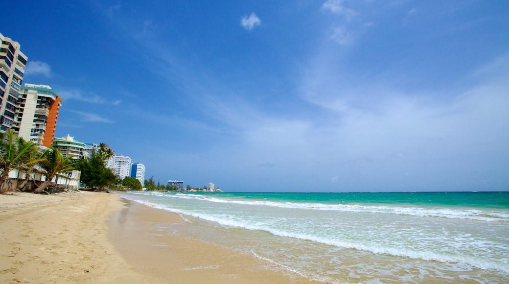 Isla Verde showing a sandy beach and a coastal town