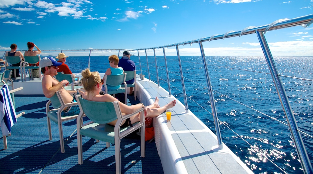 Fiji which includes boating as well as a small group of people