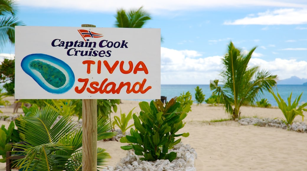 Fiji which includes signage, tropical scenes and a beach
