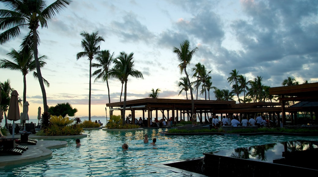 Nadi which includes tropical scenes, swimming and a sunset