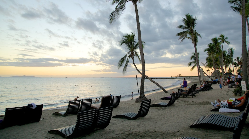 Nadi which includes a beach, a luxury hotel or resort and a sunset