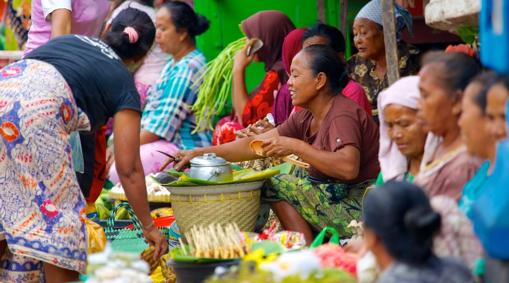 Tanjung which includes markets as well as a large group of people