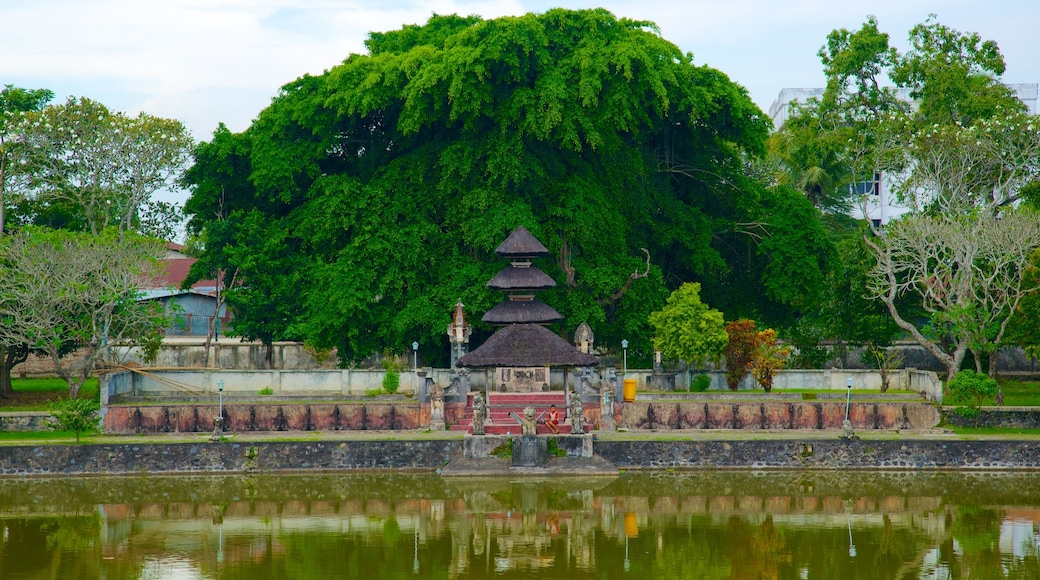 Mayura Temple and Park which includes a pond and a temple or place of worship