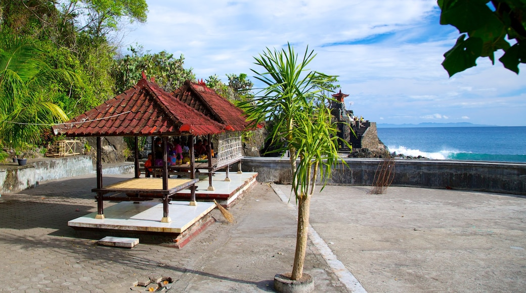 Lombok showing general coastal views and a temple or place of worship